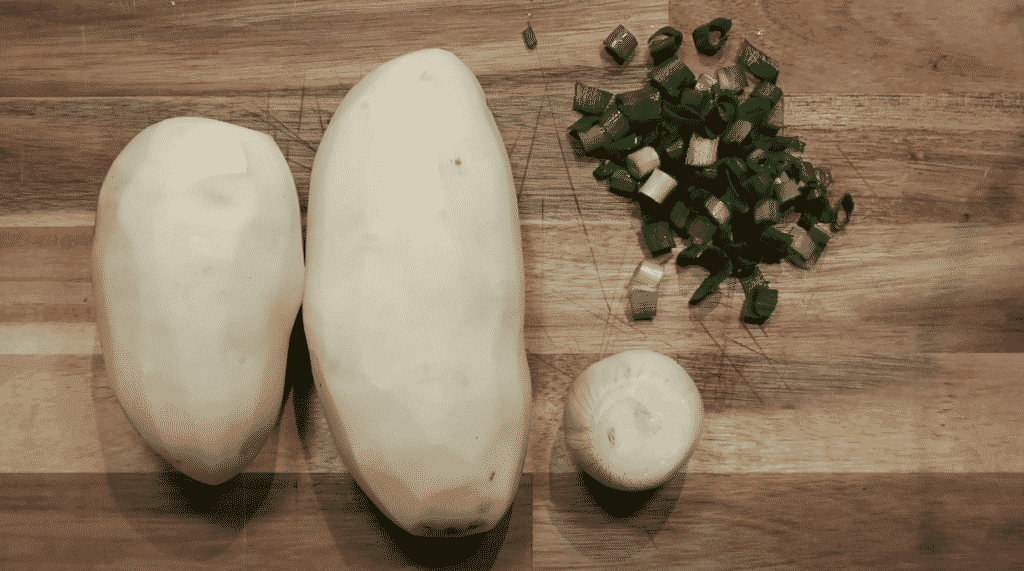 peeled potato, onion and scallion