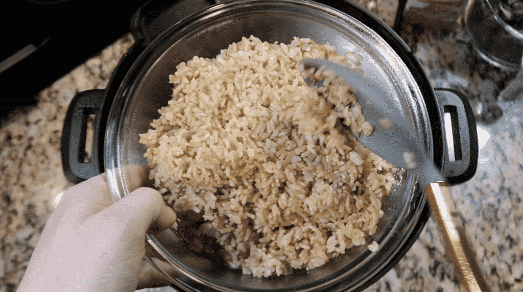 Placing rice in a bowl to rest