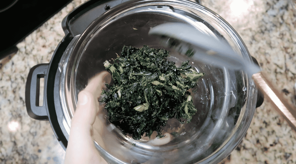 Placing kale in a bowl