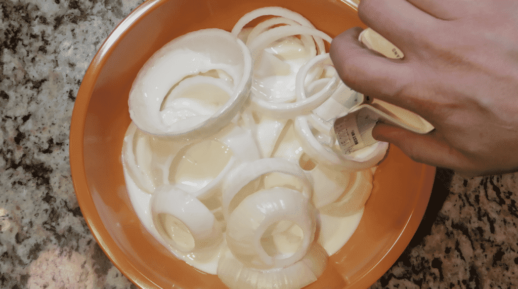 Rings in a bowl with buttermilk