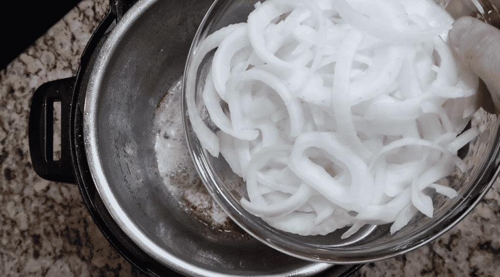 Adding onions to pot