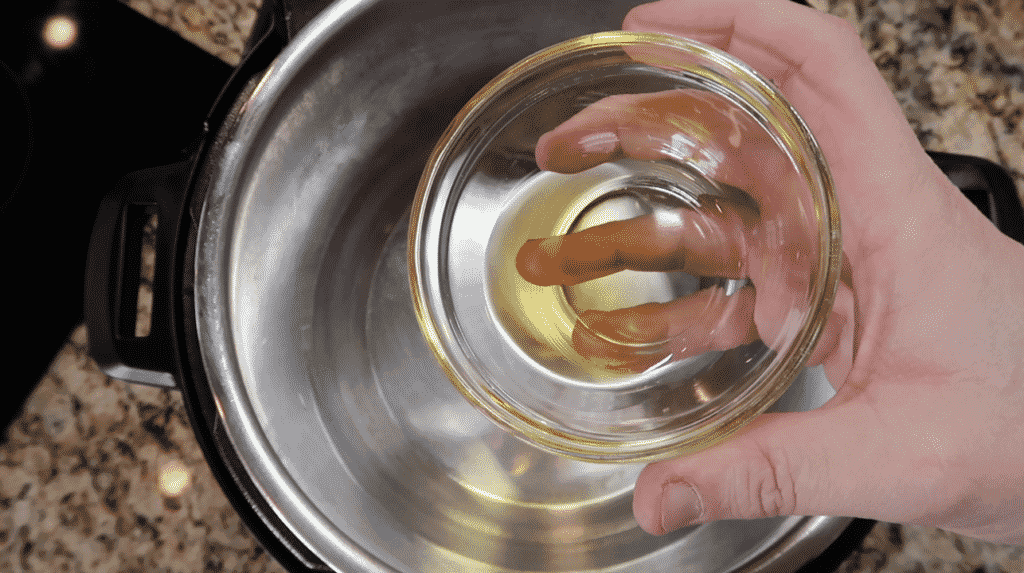 Adding olive oil to the pot