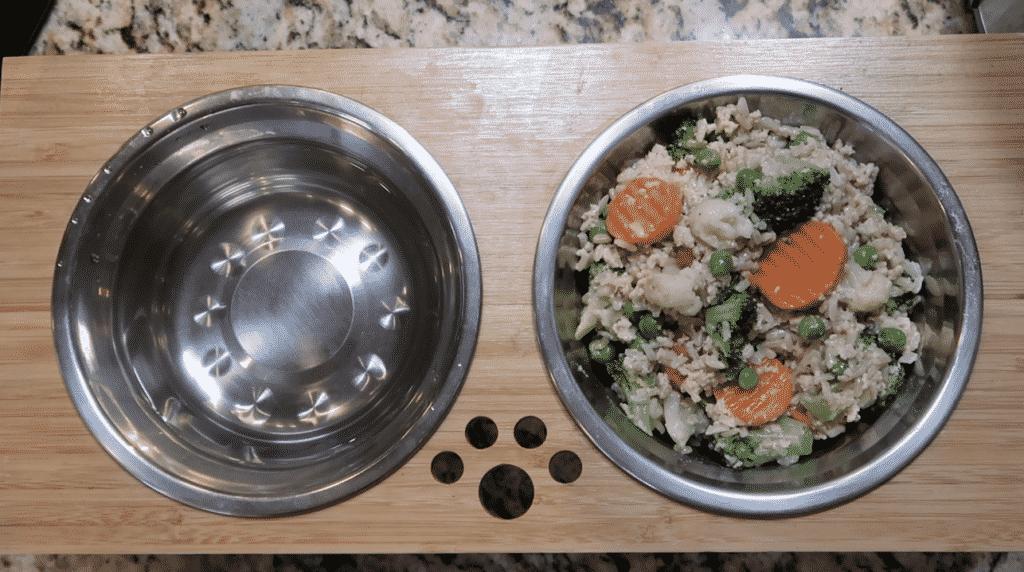Placing dog food in dog bowl.