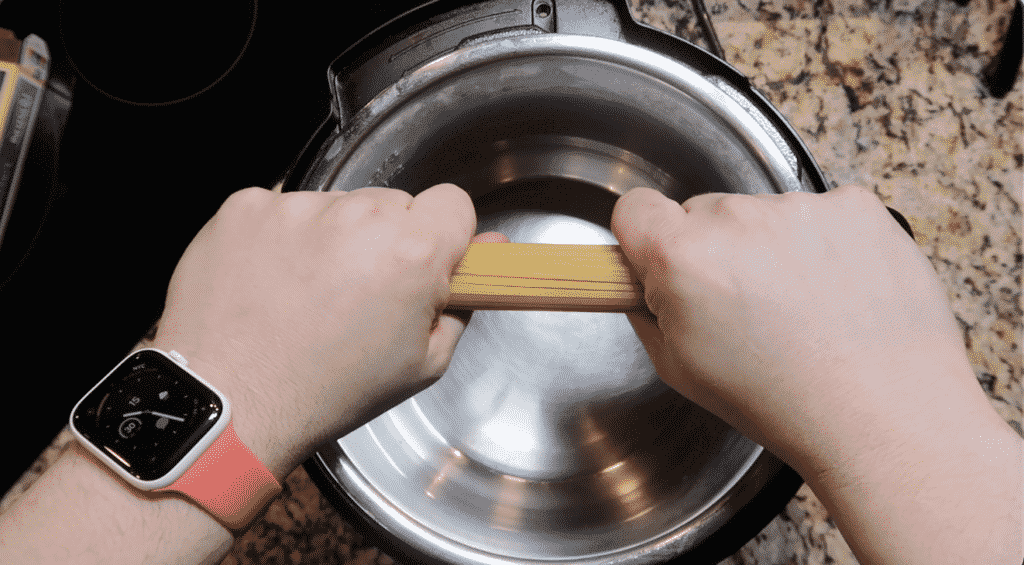 breaking linguine in half