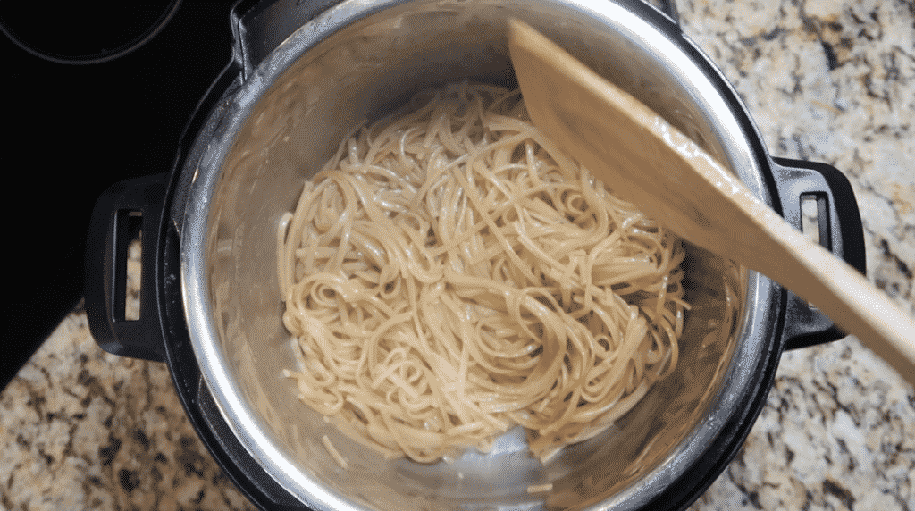 Stirring noodles in pot