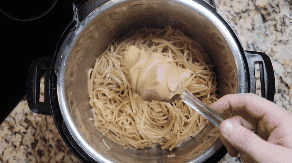 adding peanut butter to the pot