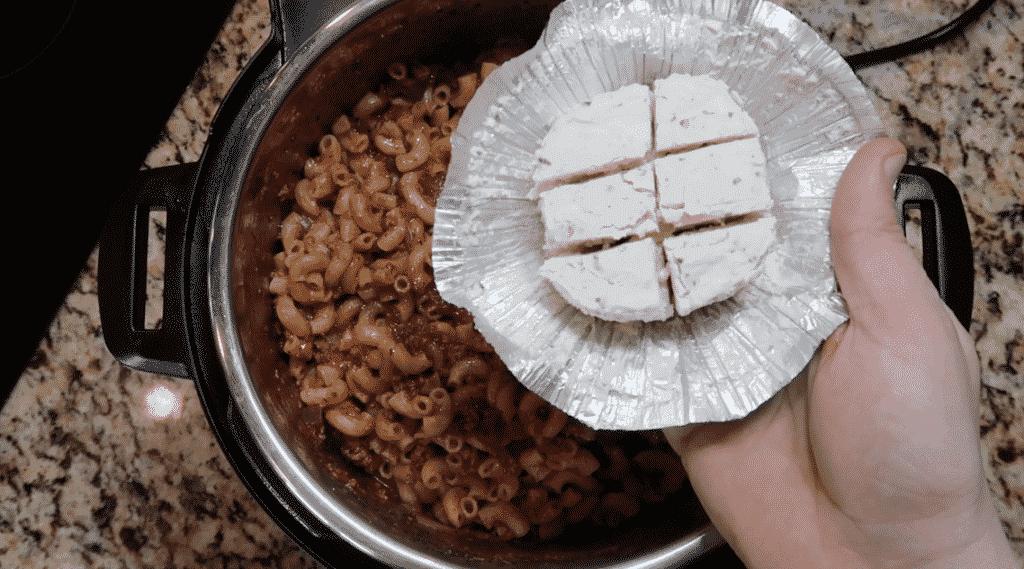 Adding cream cheese to pot