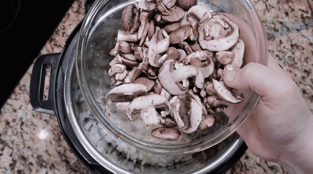 Adding mushrooms to the pot