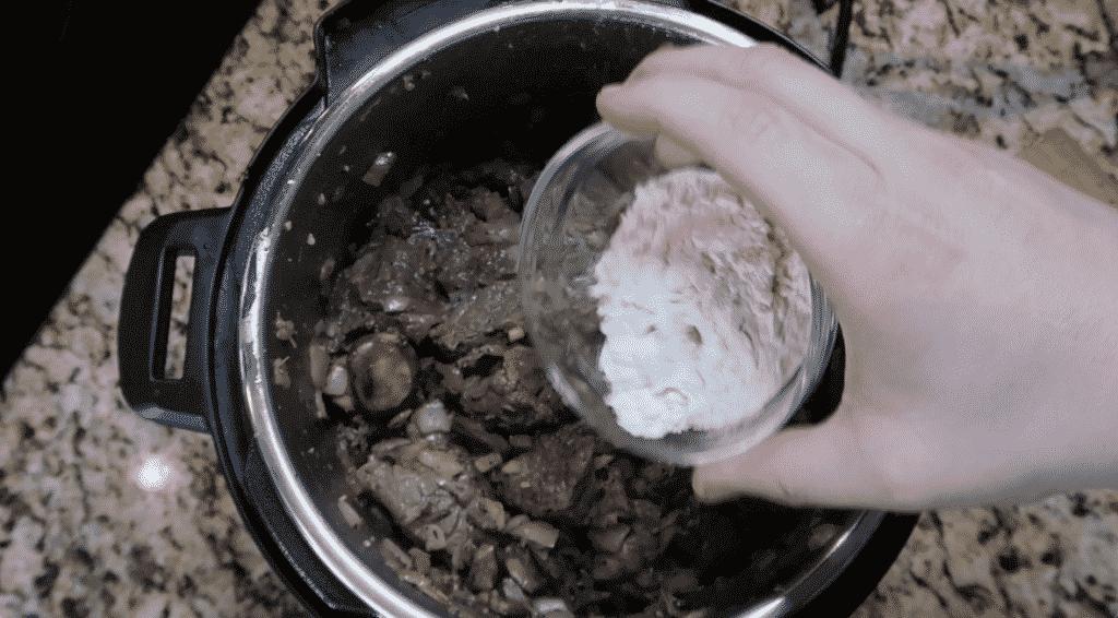 Adding flour to pot