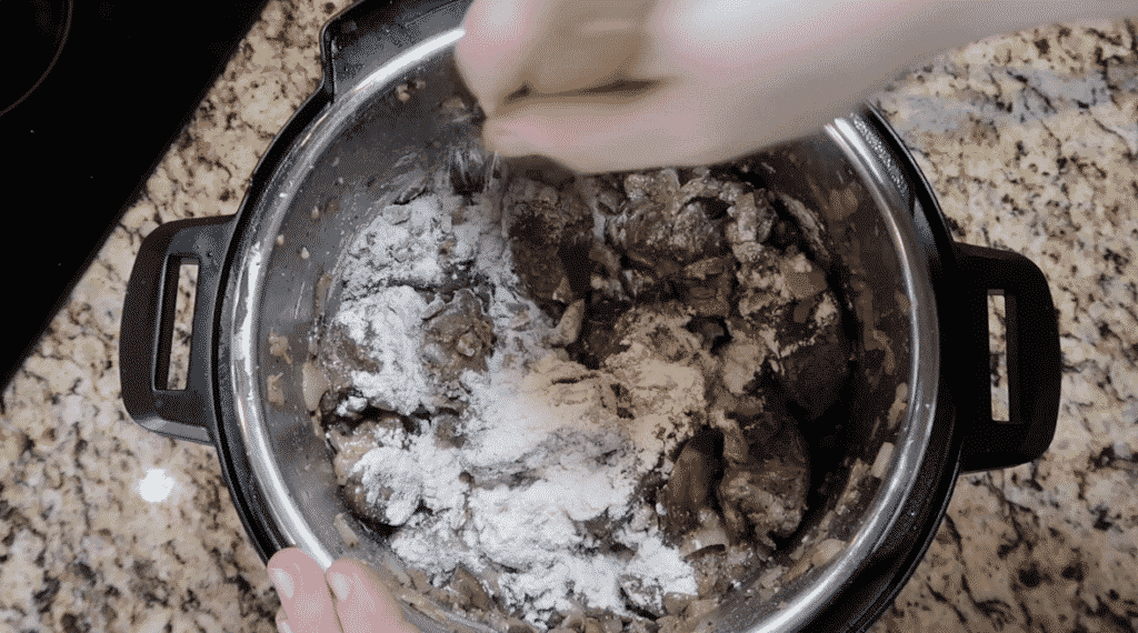 Stirring meat with flour