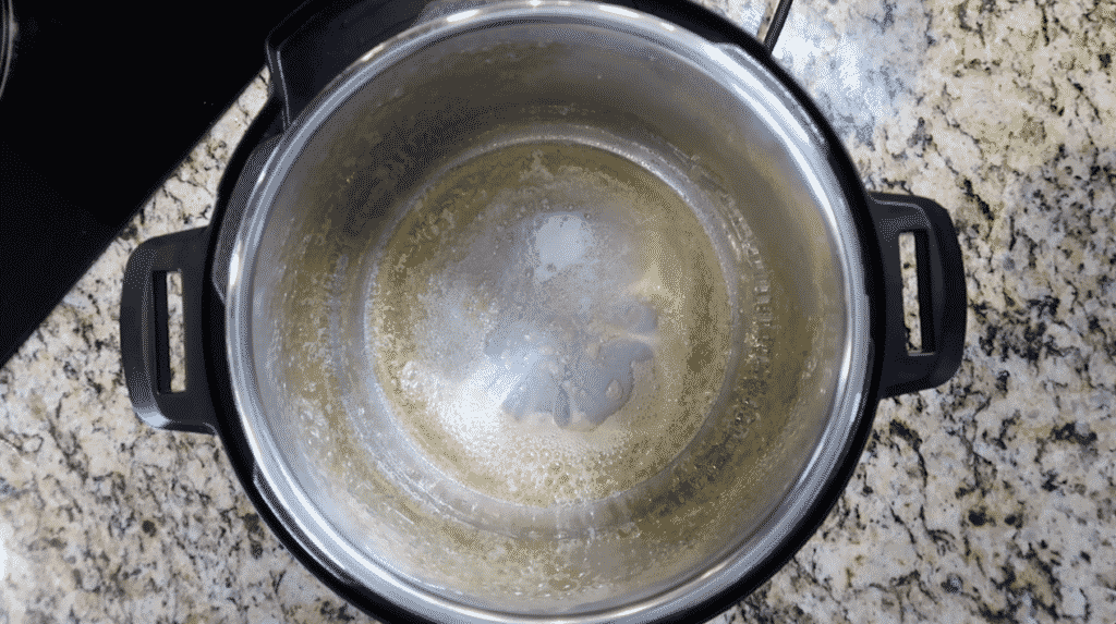 Melted butter and hot oil in pot