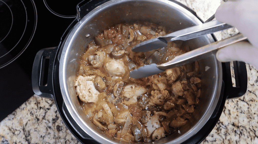 Removing cooked chicken from pot