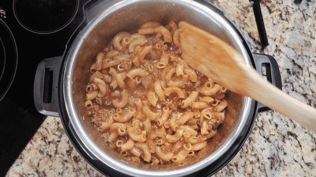 Stirring pasta.