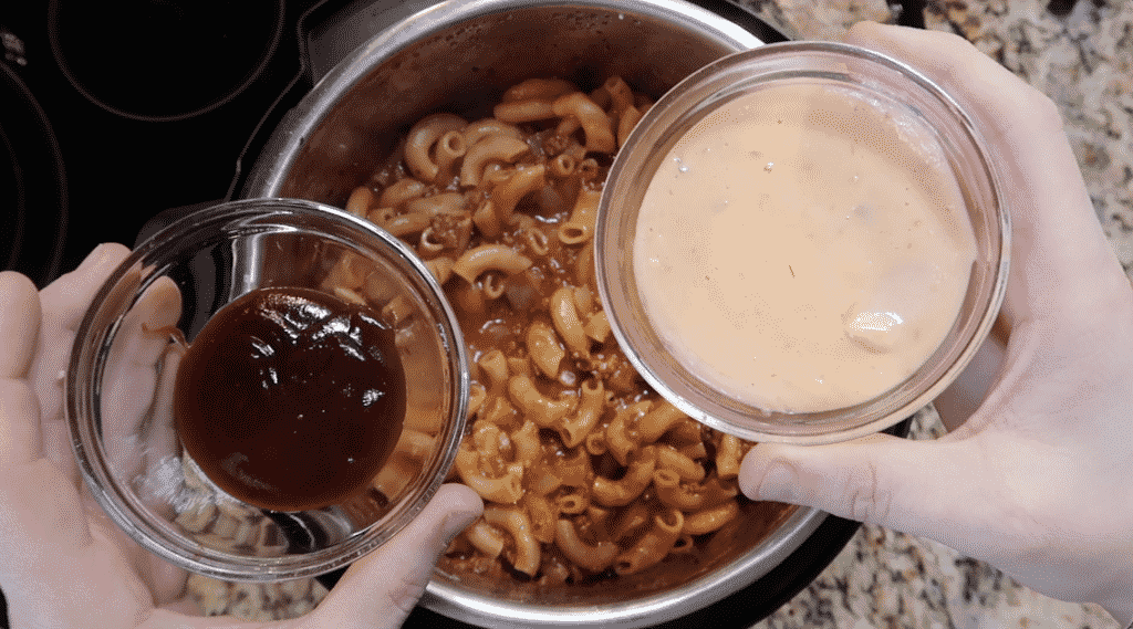 Adding Thousand Island dressing and barbecue sauce to pot
