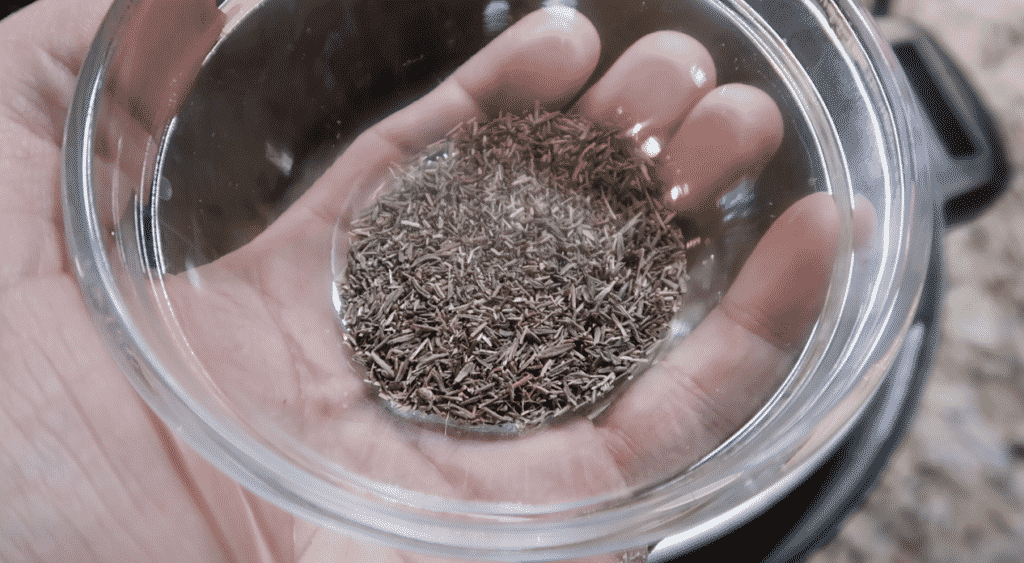 Adding dried thyme to pot.