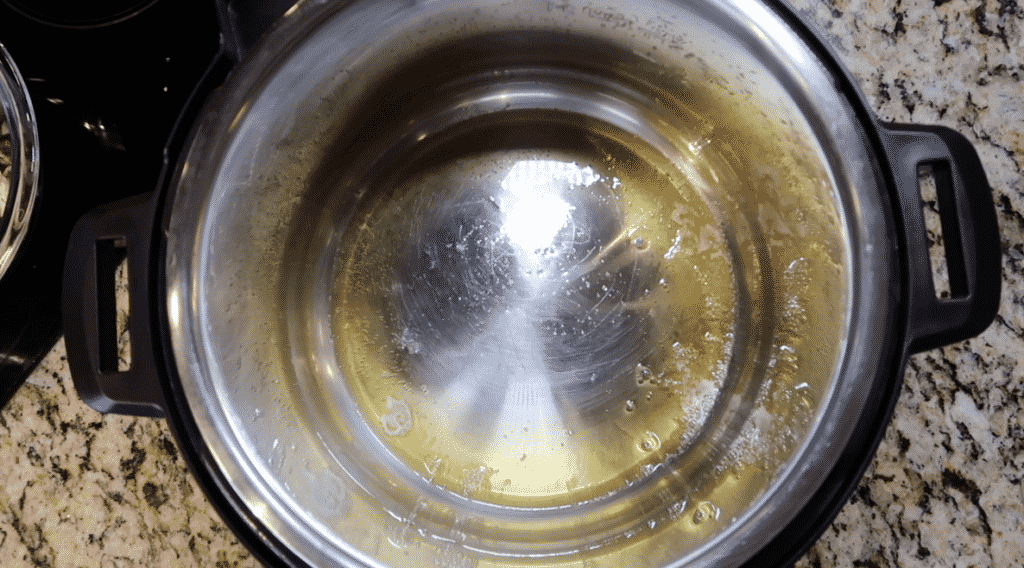 Give the pot some heat and allow the ghee to melt and the oil to heat.