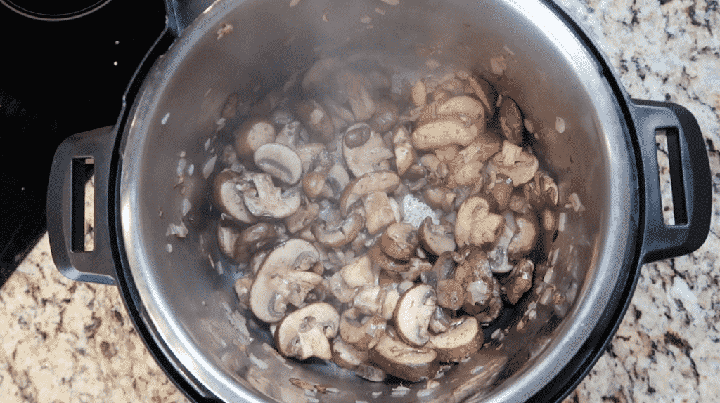 Sauté the veggies for a few minutes until the mushrooms slightly brown and cook down.
