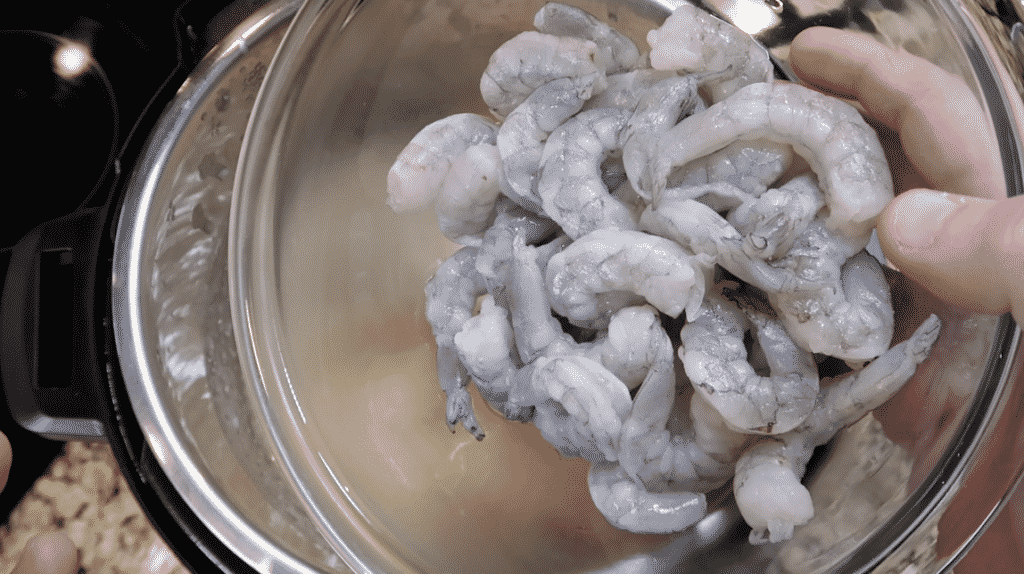 Adding shrimp to pot