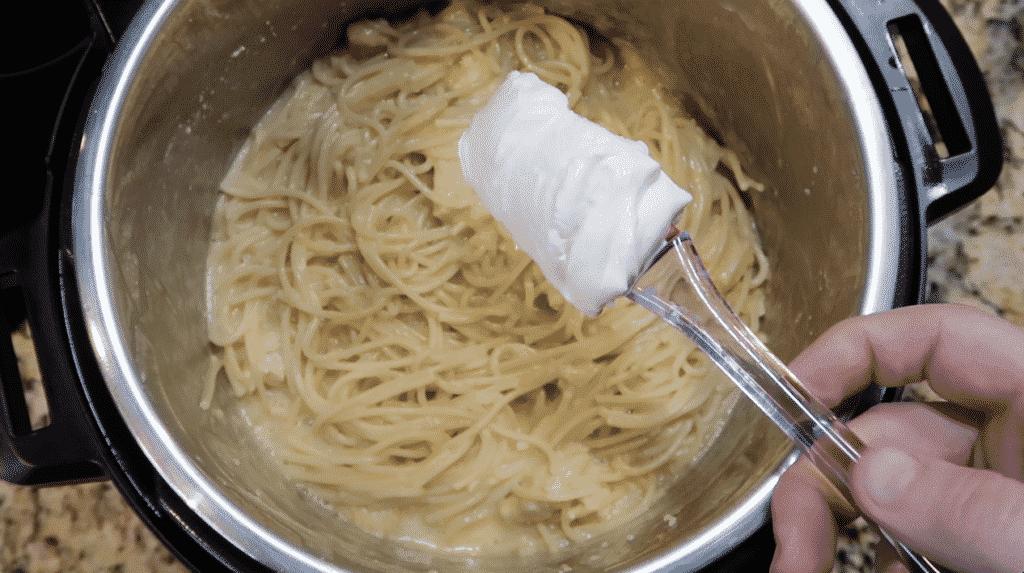 Adding sour cream to the pot