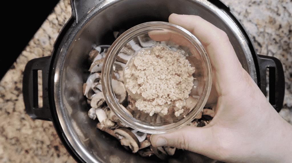 adding garlic to pot