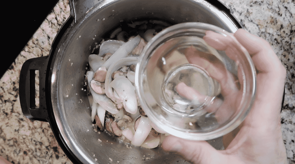 Adding more wine to pot