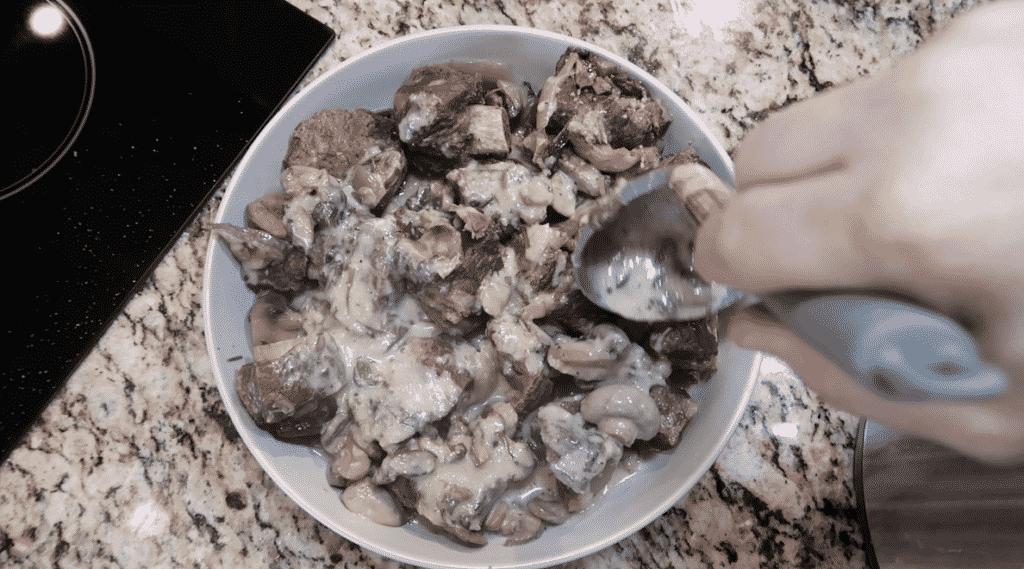 Ladling sauce over short ribs