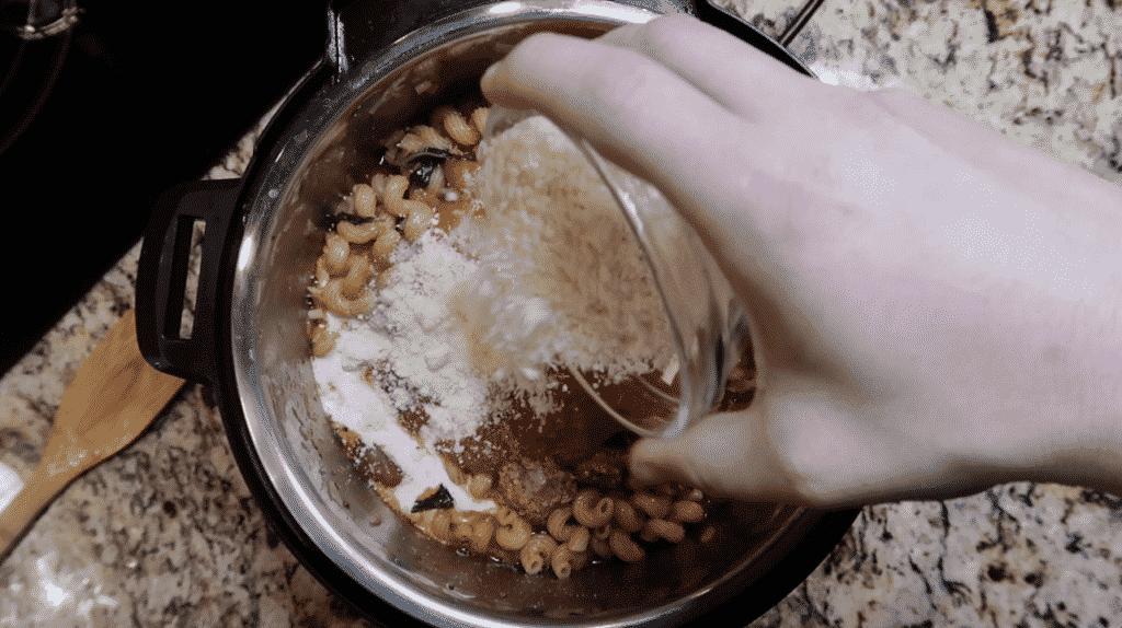 Adding Parmesan