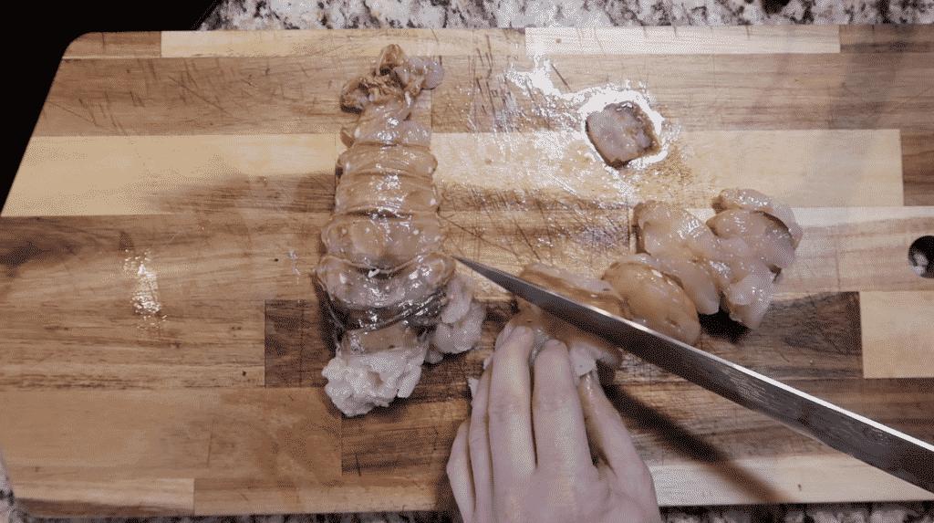 Slicing lobster meat