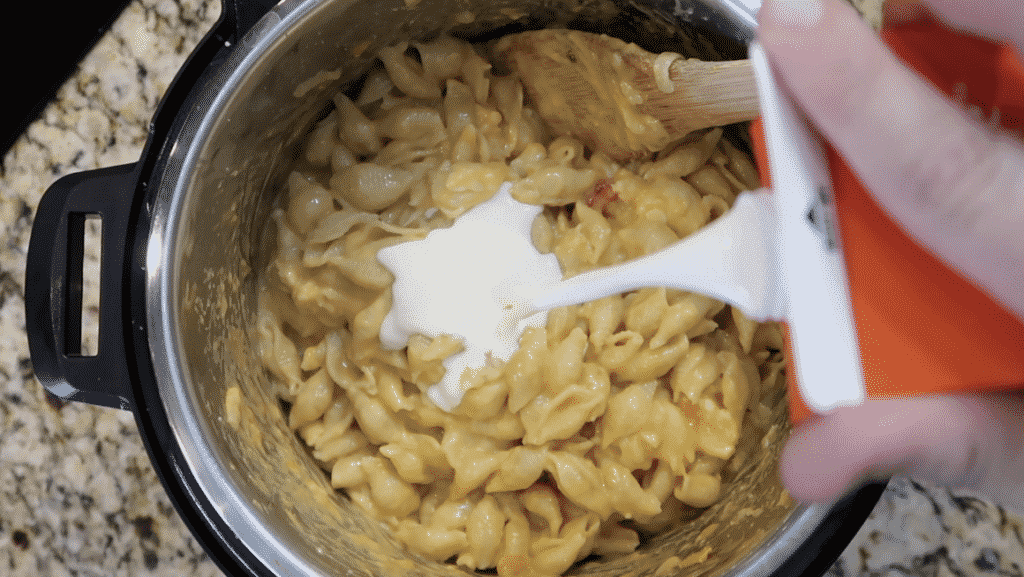 Adding cream to pot
