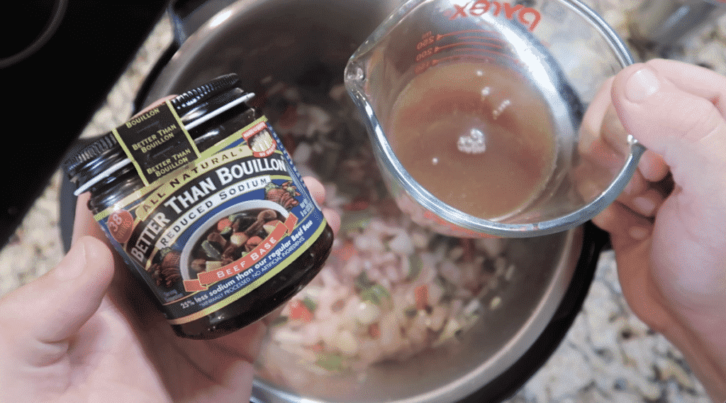 Adding beef broth to pot.