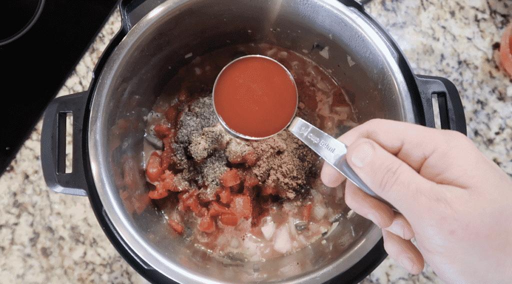 Adding taco sauce to pot