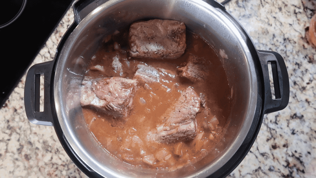 Adding short ribs to pot