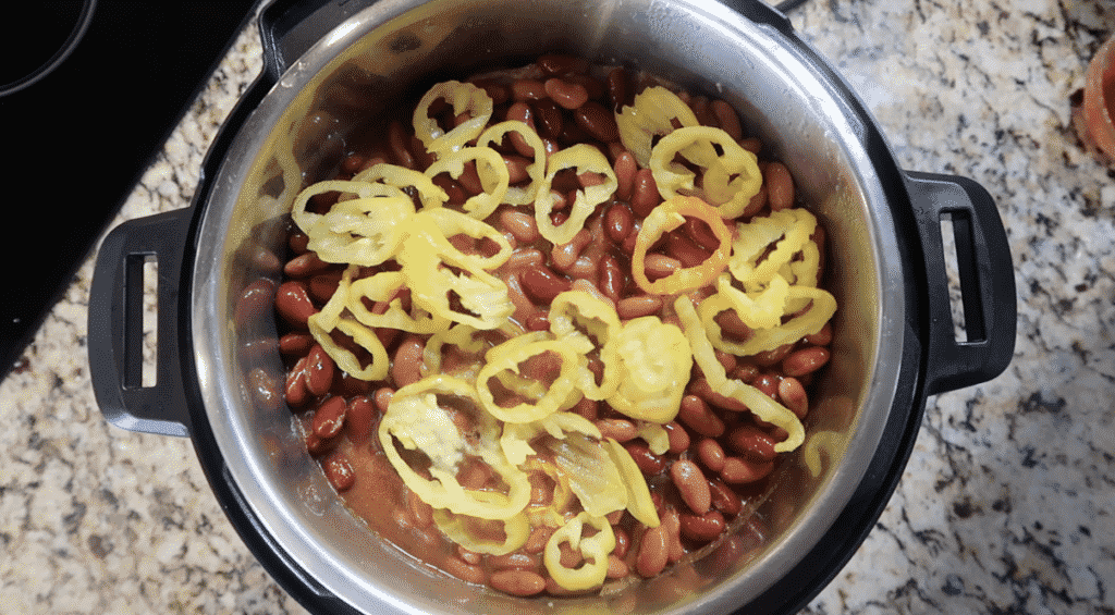Adding banana peppers to pot