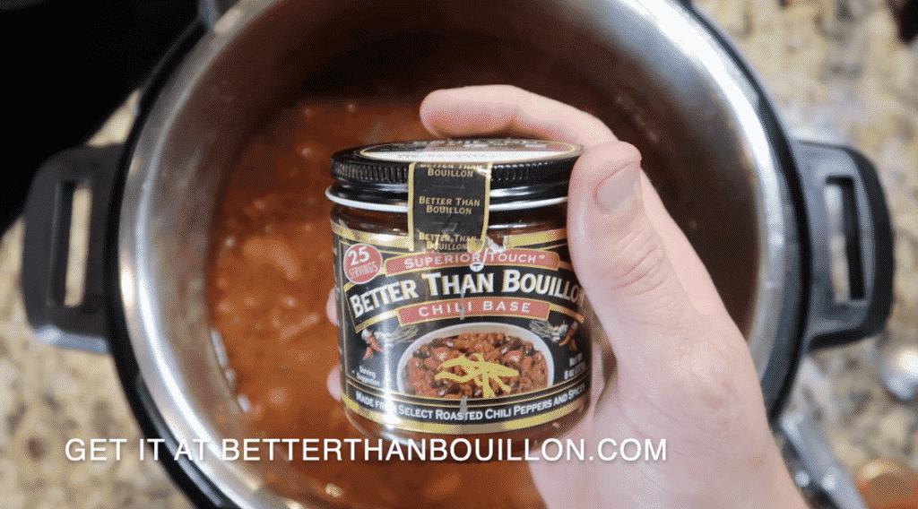 Adding Chili Better Than Bouillon to pot