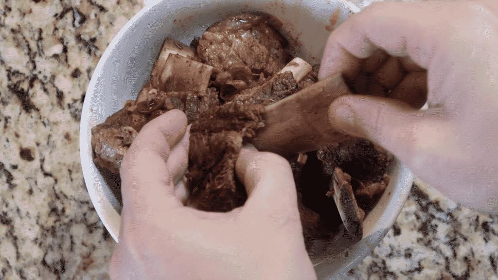 Sliding bones out of short ribs.