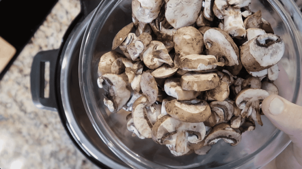 Adding mushrooms to pot