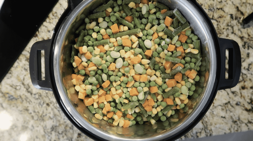 Adding frozen vegetables to pot
