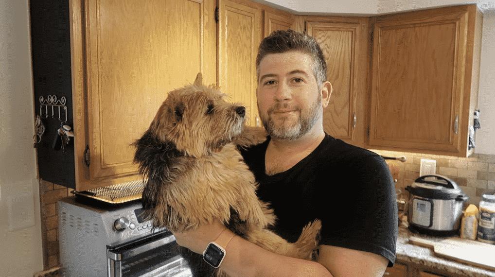 Man holding dog.